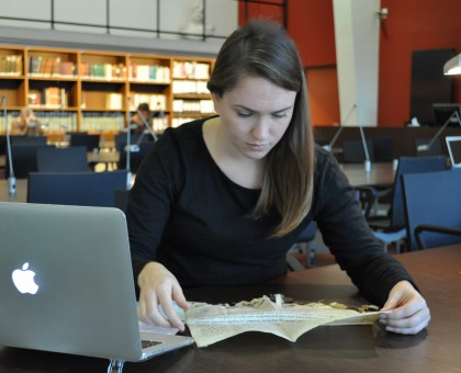 Photo of Graduate Student Sarah Hanson conducting archival research in Lille.