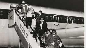 black and white image of people deplaning from BOAC airplane