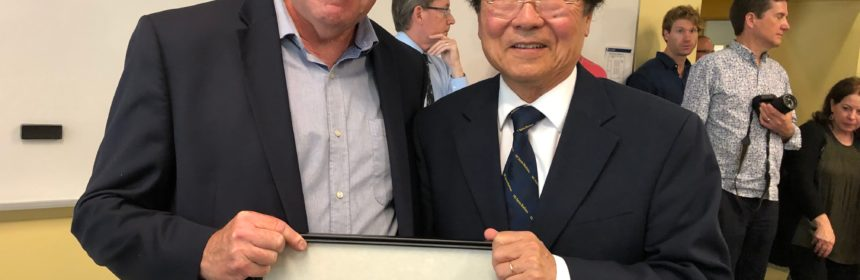 Professor Nelson Lichtenstein Given Top Honor pictured with another person and people mill about in the background