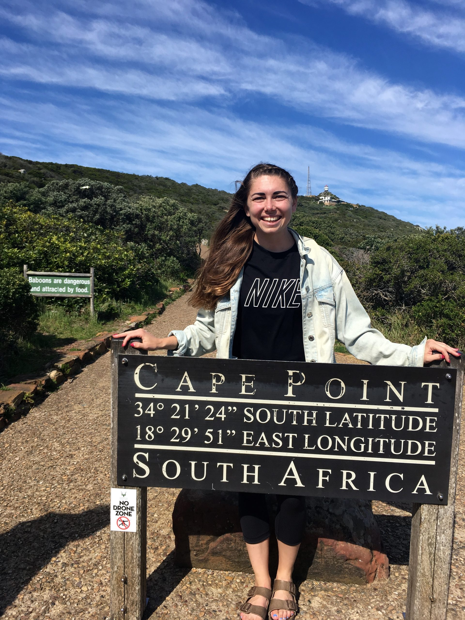 Mattie Webb in front of Cape Point South Africa sign
