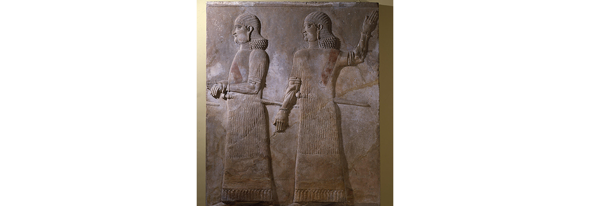 Two beardless Assyrian officials stone wall mural