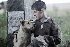film still of a boy and a dog from film Run Boy Run